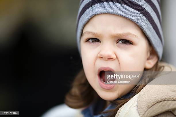 Close up of cute baby girl with hat