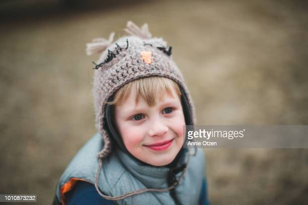 Close up of cute little boy wearing a homemade crochet hat