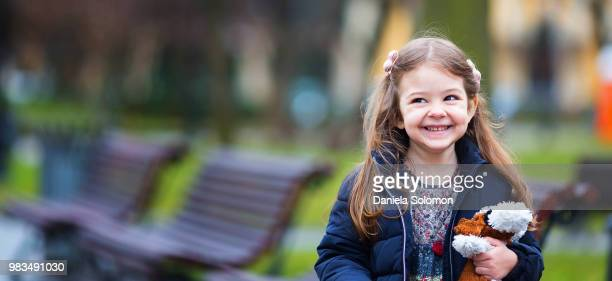 close up of cute little girl - hair bow stock pictures, royalty-free photos & images