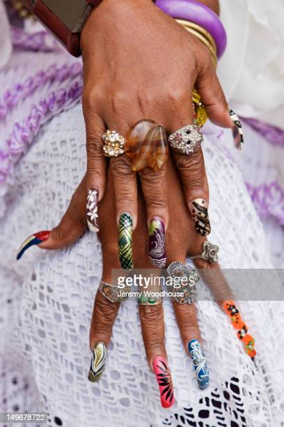 Close up of decorated long fingernails