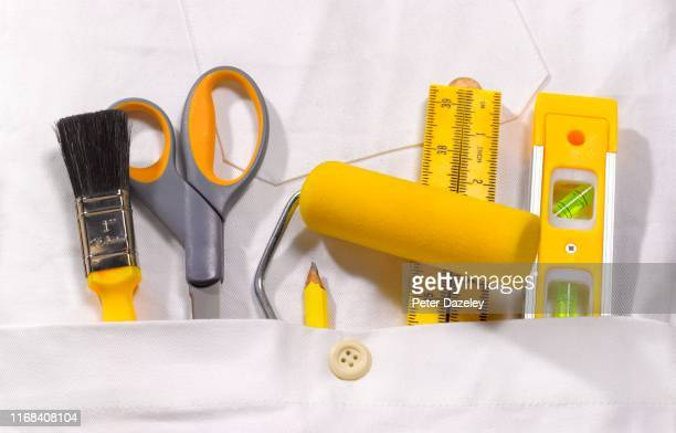 close up of decorator's overall pocket - white jumpsuit stock pictures, royalty-free photos & images