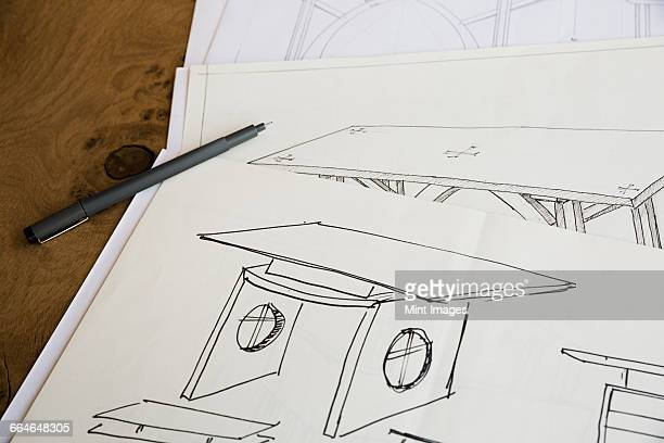 Close up of design drawings for furniture, a table.