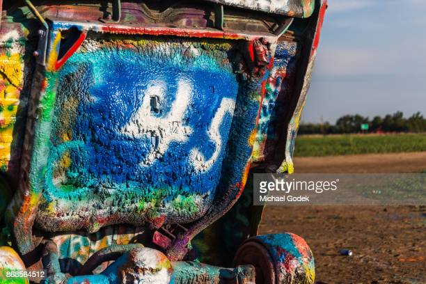 A close up of details spray painted on Cadillac Ranch
