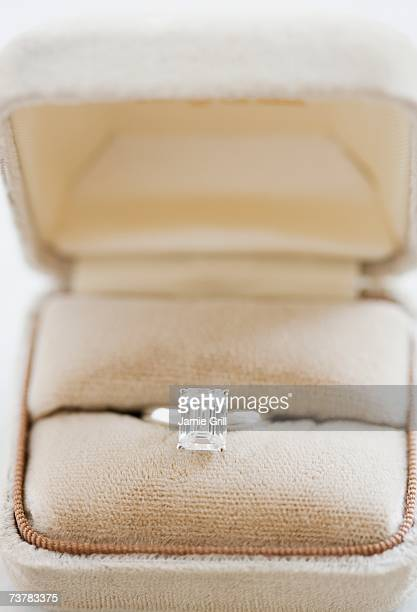 Close up of diamond engagement ring in box