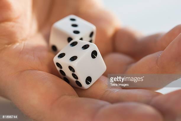 close up of dice in man?s hand - dobbelsteen stockfoto's en -beelden