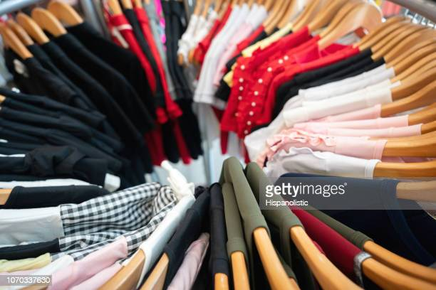 close up of different types of shirts on coat hangers - womenswear stock pictures, royalty-free photos & images