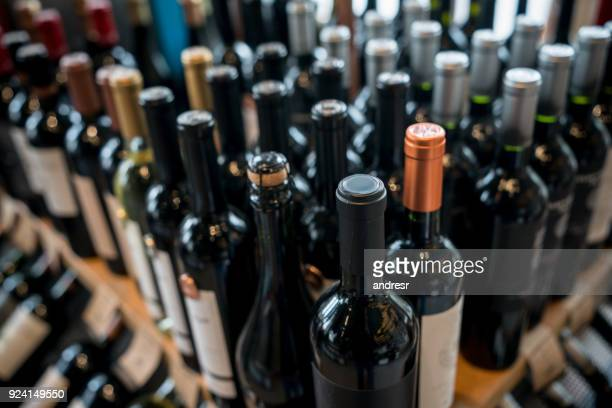 close up of different wine bottles at a wine store - wine bottle stock pictures, royalty-free photos & images