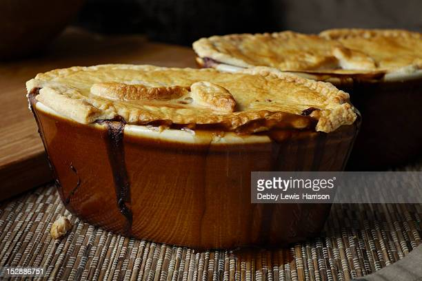 Close up of dishes of baked pie