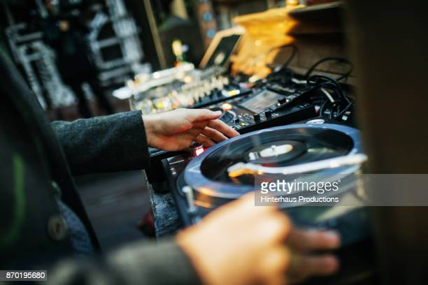 Close Up Of DJ Mixing With Vinyl At Open Air Nightclub