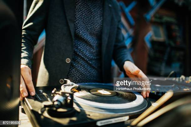 Close Up Of DJ Performing At Open Air Nightclub