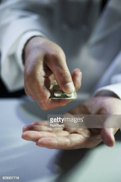 close up of doctor holding pack of medicine - anti depressant stock pictures, royalty-free photos & images