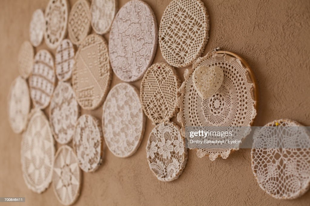 Close Up Of Doilies On Wall : Stock Photo