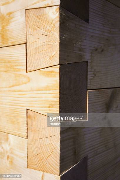 close up of dovetail wooden corner of built structure - 組み合わさる ストックフォトと画像