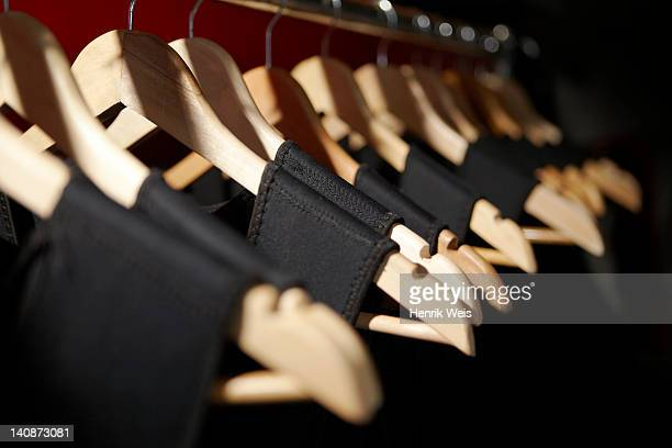 Close up of dresses on clothes hangers