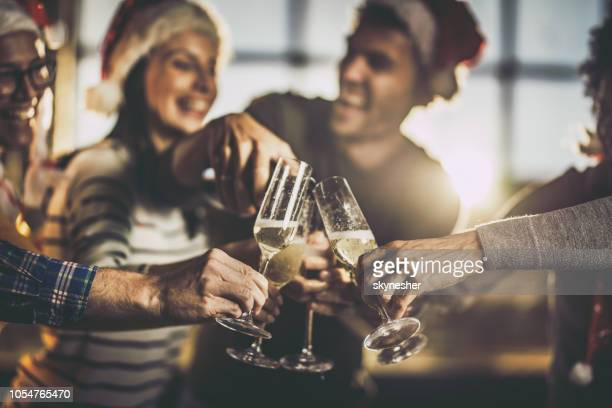 close up of drinking champagne on new year's party. - christmas party stock photos and pictures