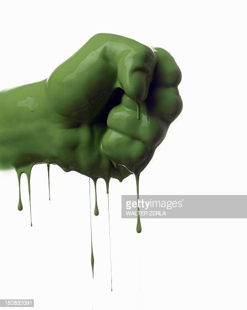 Close up of dripping green fist