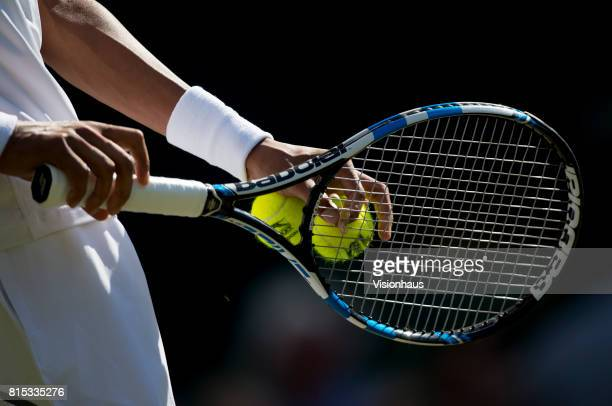 A close up of Dustin Brown of Germany's Babolat racket during his match against Andy Murray of Great Britain on day three of the Wimbledon Lawn...