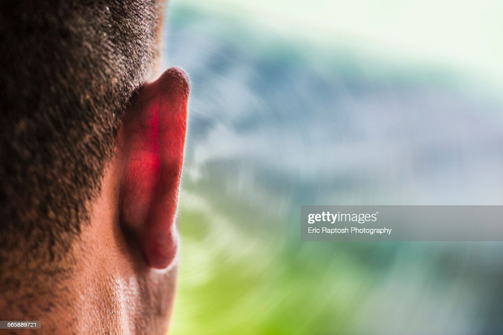 Close up of ear of Caucasian man and sound waves : Stock Photo
