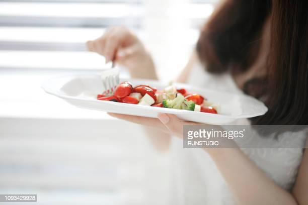 close up of eating salad - image stock pictures, royalty-free photos & images