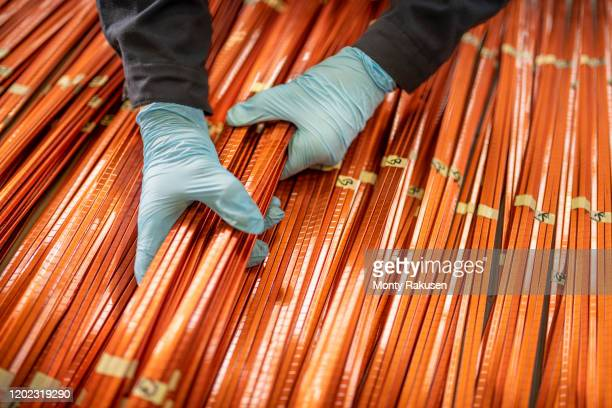 close up of electrical engineer inspecting copper windings in electrical engineering factory - close up stock pictures, royalty-free photos & images