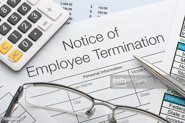 close up of employee termination form - employment law stock photos and pictures