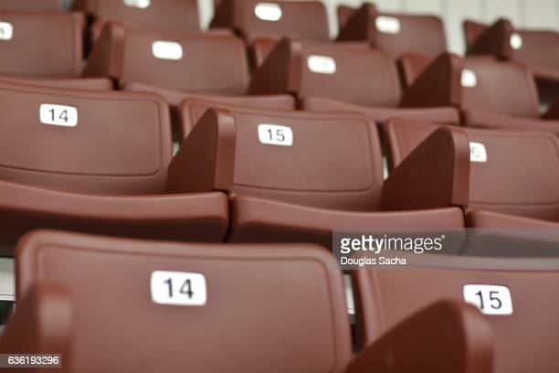 Close up of empty plastic molded theater seating