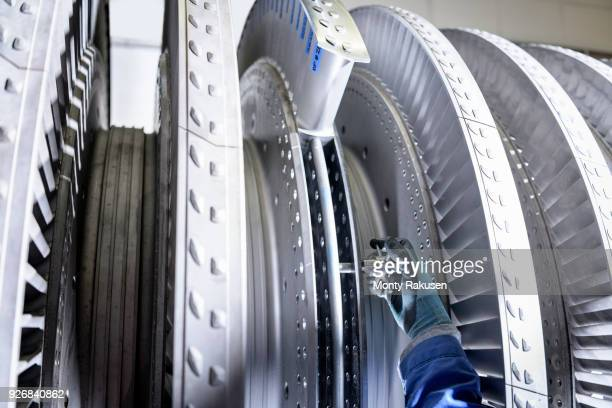 Close up of engineer working on high pressure steam turbine in turbine maintenance factory