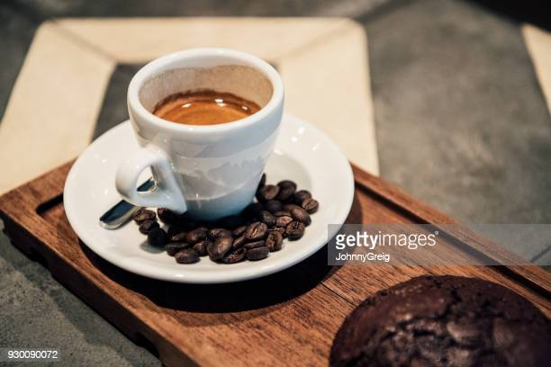 Close up of espresso and coffee beans