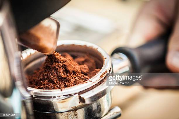 close up of espresso grounds in machine - ground coffee stock photos and pictures