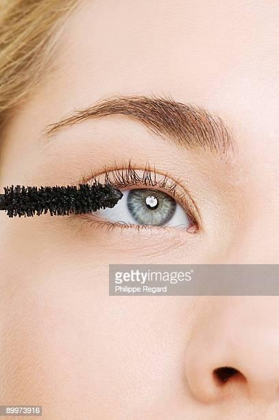 Close up of eye with mascara brush