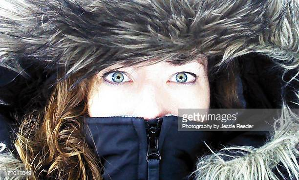 Close up of face and eyes in winter coat hood
