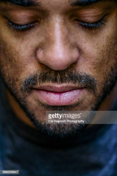 close up of face mixed race man looking down - 30 34歳 ストックフォトと画像