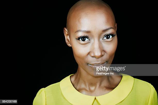 close up of face of african american woman - bald woman stock photos and pictures