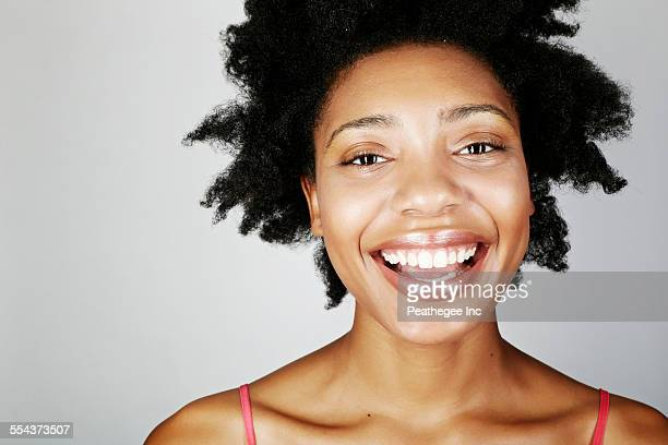 Close up of face of laughing black woman