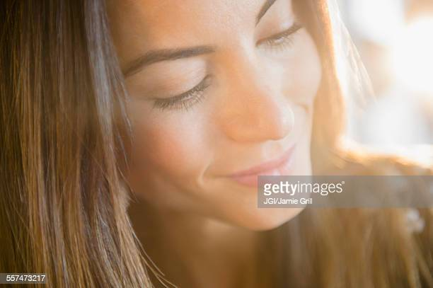 Close up of face of smiling Caucasian woman