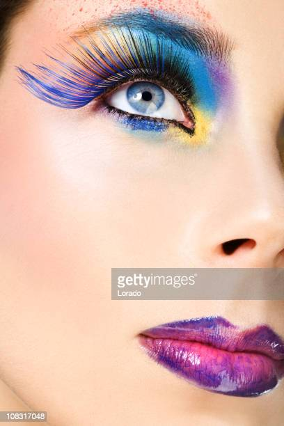 close up of face with multicolored make-up