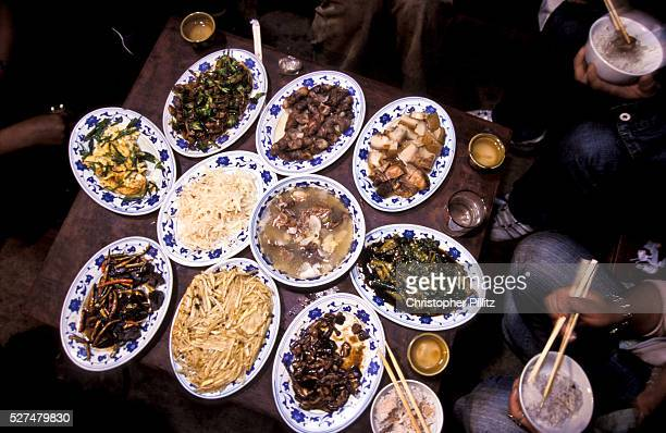 'Close up of family meal in home close to the shores of Lugu Lake northwest Yunnan province Mo Suo people live along LuGu lake northwest Yunnan...