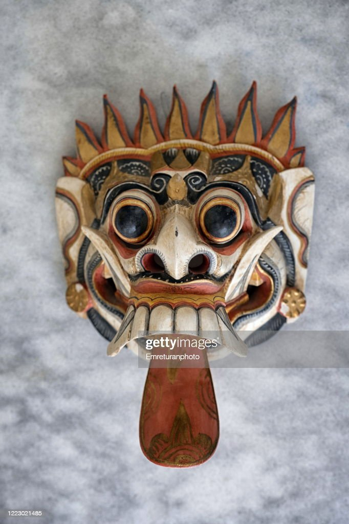 Close up of far eastern decoration mask on gray tabletop. : Stock Photo