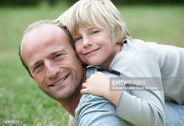 Close up of father and son smiling