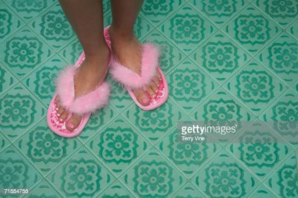 close up of feet in flip flop slippers - pretty asian feet stock photos and pictures