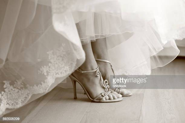 Close up of feet of bride in wedding shoes
