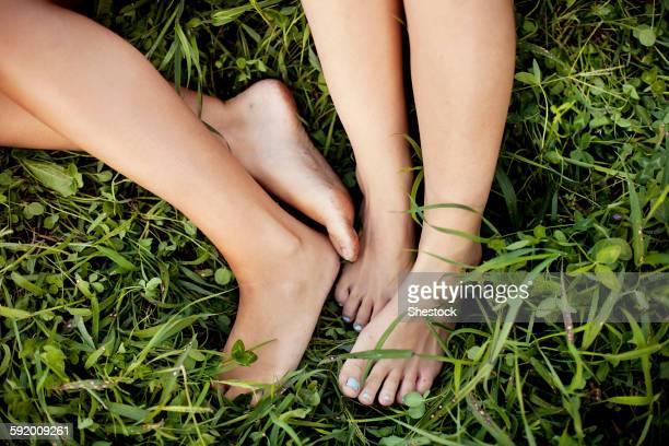 Close up of feet of Caucasian women in grass