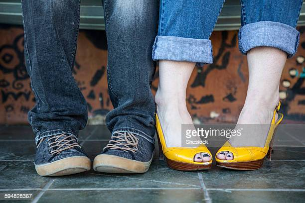 Close up of feet of sitting couple
