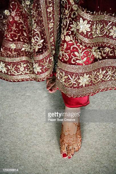 Close up of feet with henna tattoo design