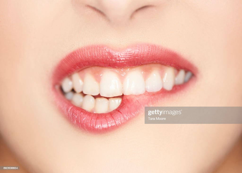 close up of female biting lips : Stock Photo
