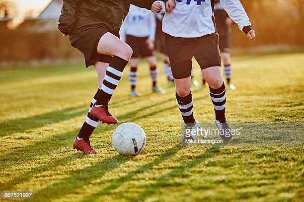 close up of female footballers footwork - futebol imagens e fotografias de stock