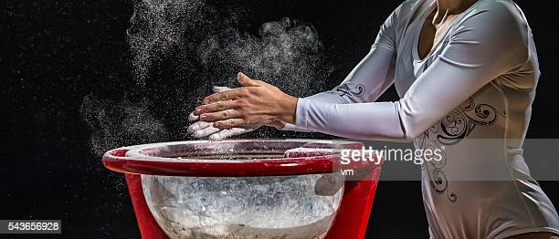 Close Up Of Female Gymnast Chalking His Hands