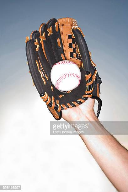 close up of female hand holding ball wearing baseball glove, miami, florida, usa - baseball glove stock pictures, royalty-free photos & images