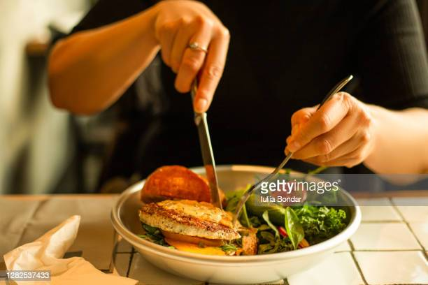 close up of female hands holding delicious bacon burger - turkey burger stock pictures, royalty-free photos & images
