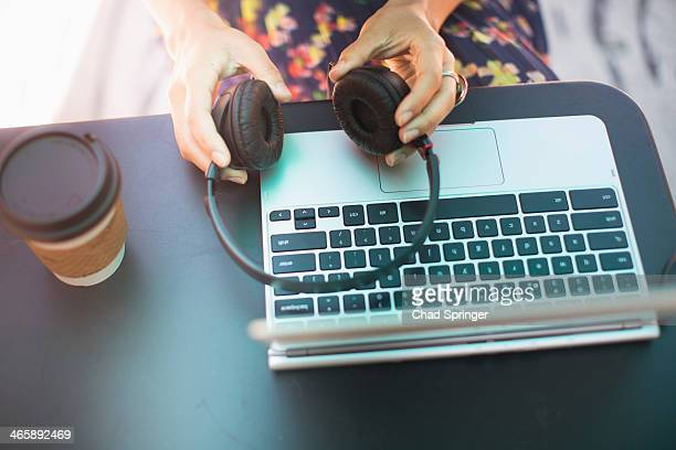 Close up of female hands holding headphones